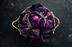 Purple cabbage in a wooden box. Organic food. Top view. Free space for your text royalty free stock image