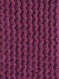 Purple cable knitting stitch Royalty Free Stock Photos