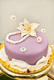 Purple cake with lily flower Stock Image