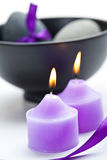 Purple candels and black pot Stock Images