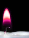 Purple candle flame royalty free stock images