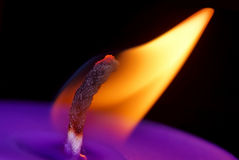 Purple candle flame at night macro Stock Photography