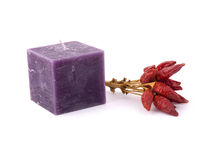 Purple candle and red capsicum Stock Photo