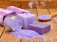 Purple candle and sea salt Royalty Free Stock Image