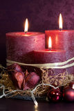 Purple candles for christmas Royalty Free Stock Photography