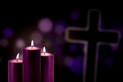 Purple candles with a cross symbol Royalty Free Stock Images