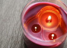 purple candles on grey wooden table, top view Royalty Free Stock Photos