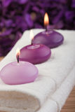 Purple candles on massage towel (2) Royalty Free Stock Images