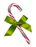Purple candy cane with green bow, isolated Royalty Free Stock Photos
