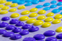 Purple candy dots on tray Royalty Free Stock Images