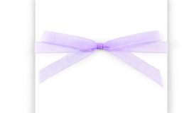 Purple capron ribbon with a bow isolated on white Stock Photos