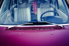 Purple Car Hood With Stainless Steel Window Wiper royalty free stock photography