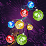 Purple card with christmas balls Stock Photography