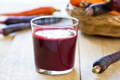 Purple Carrot juice royalty free stock image