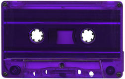 Purple cassette tape. Retro purple plastic cassette tape Royalty Free Stock Image