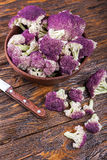 Purple cauliflower on a wooden table Royalty Free Stock Image