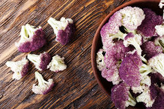 Purple cauliflower on a wooden table Stock Images