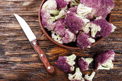 Purple cauliflower on a wooden table Stock Photography
