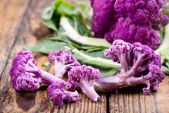 Purple cauliflower on a wooden table. Close up of purple cauliflower on a wooden table Royalty Free Stock Photo