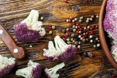 Purple cauliflower , on a wooden table. top view. Purple cauliflower , on a wooden table Royalty Free Stock Photography