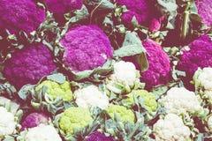 Purple cauliflowers on a farmers market stand in Sicily, Italy. Purple cauliflowers on a farmers market stand in Sicily, Italy Royalty Free Stock Photo
