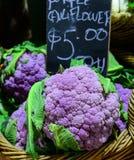 Purple cauliflowers for sale Royalty Free Stock Image