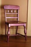 Purple Chair. A metallic purple chair against a tan wall Royalty Free Stock Photo