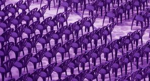 Purple chairs for audience. Royalty Free Stock Images