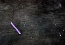 Purple Chalk and Blank Chalkboard Stock Photo