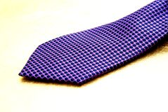 Purple check tie on gold Stock Images