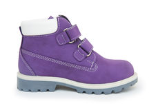 Purple children`s boots isolated on white Royalty Free Stock Images