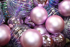 Purple Christmas. Assorted shiny purple Christmas bulbs in a basket stock image