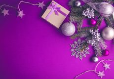 Purple Christmas background with a present Stock Image