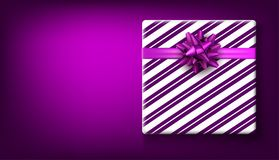 Purple New Year background with gift. Purple Christmas background with striped gift box and bow. Vector top view illustration Stock Photo