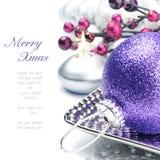 Purple Christmas ball on festive background. Purple Christmas ball on silver festive background Stock Photos