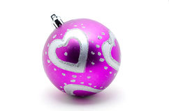 Purple Christmas ball with heart pattern. Stock Images