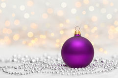 Purple Christmas ball with metallic beads Stock Image