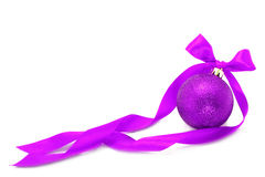 Purple Christmas ball with ribbon Stock Image