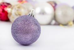 Purple christmas ball Royalty Free Stock Photo