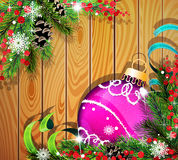Purple Christmas ball on wooden background. Purple Christmas ball, cones, berries and fir tree branches on wooden background Stock Images