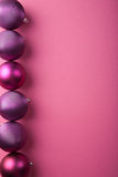 Purple christmas balls border Royalty Free Stock Photos