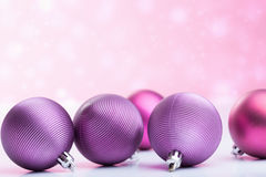 Purple christmas balls over blurred background Royalty Free Stock Image