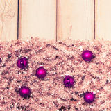 Purple christmas balls on silver tree garland Royalty Free Stock Photo
