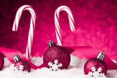Purple christmas balls on snow Stock Photos