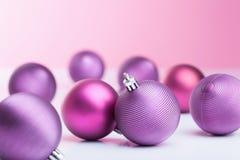 Purple christmas balls winter decoration Stock Photos