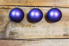 Purple christmas balls on a wooden background Stock Photo