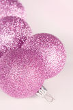 Purple Christmas baubles closeup royalty free stock image