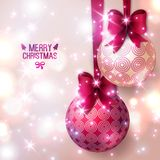 Purple Christmas baubles on light background. Stock Image