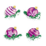 Purple Christmas Baubles in Twigs Snow Royalty Free Stock Photos