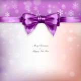 Purple christmas bow with ribbon and snowflakes Stock Photo